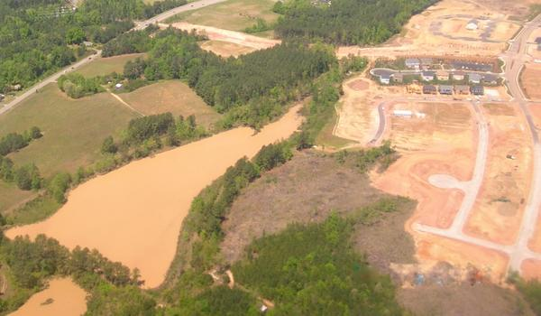Aerial photo of a pond showing effects of turbidity.
