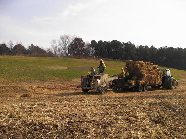 Photo of crew applying straw with a blower
