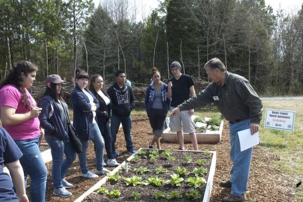 presentation to youth by garden coordinator