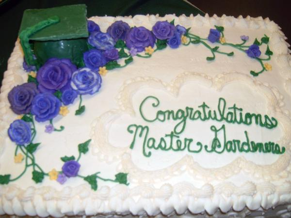 "Photo of a cake saying ""congratulations master gardeners"""