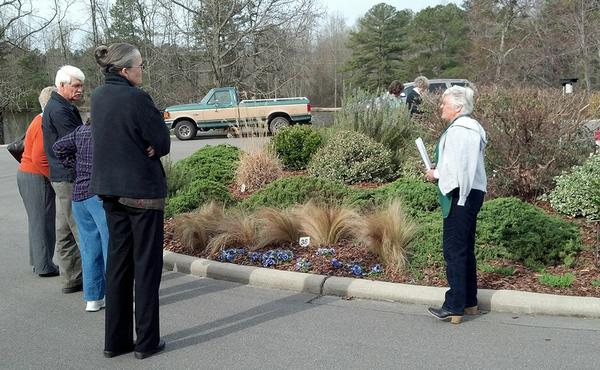 Photo of master gardeners giving a tour of a demonstration garde