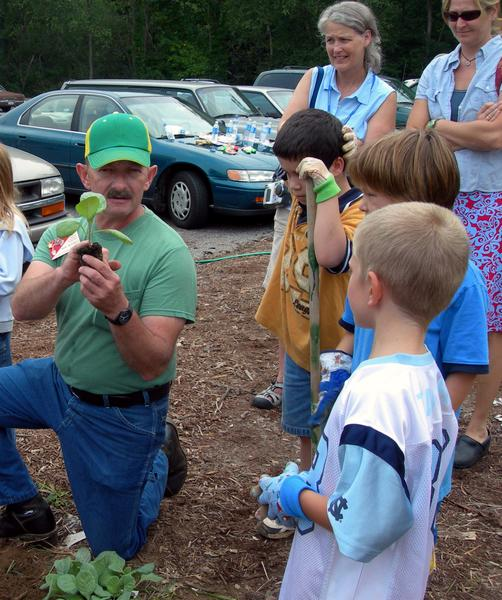 Photo of master gardener with students in Buncombe County