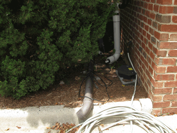 Pipe downspout connected to gutter on the ground