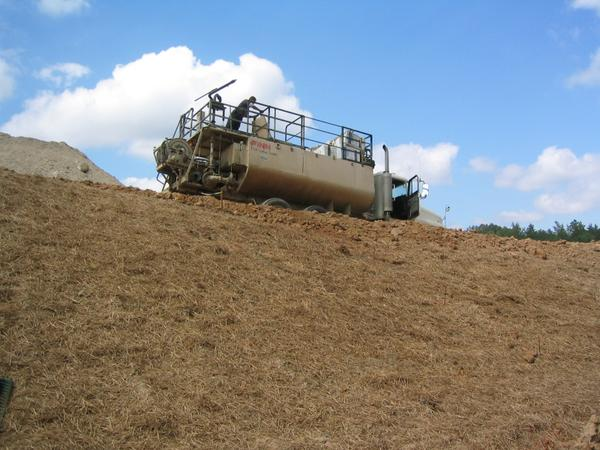Figure 2. Hydromulch is being applied to straw as a tackifier us