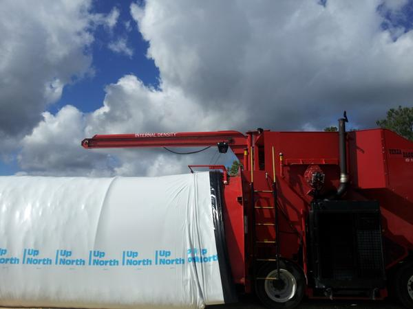 Photo of a silo bag being filled.