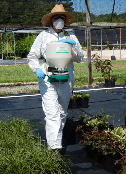 Using a Hand-Cranked, Hand-Held Spreader to Apply Herbicides