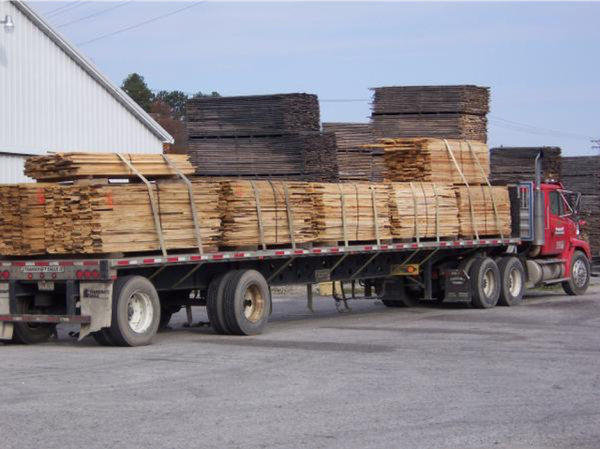 Hardwood lumber loaded for delivery to downstream users