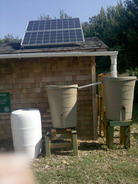 Photo of solar cells and rain barrels for water collection
