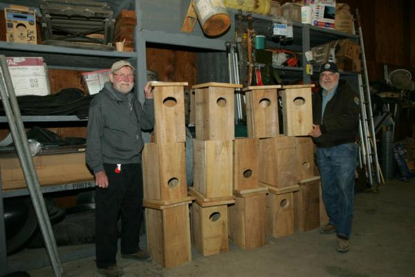 Photo of volunteers with new wood boxes