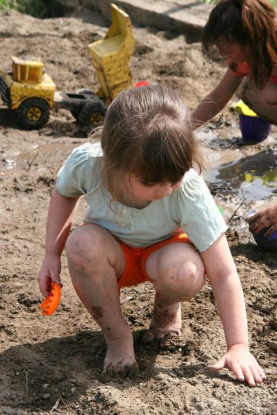 Photo of a child playing in the dirt.