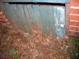 Figure 3. Unsealed crawlspace door.