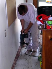 Drilling a garage slab floor to treat for termites