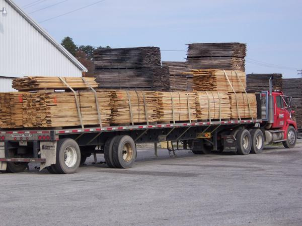 Hardwood lumber loaded for delivery to downstream users.