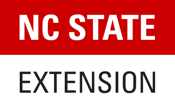 Red rectangle with NC State and Extension below in black letters