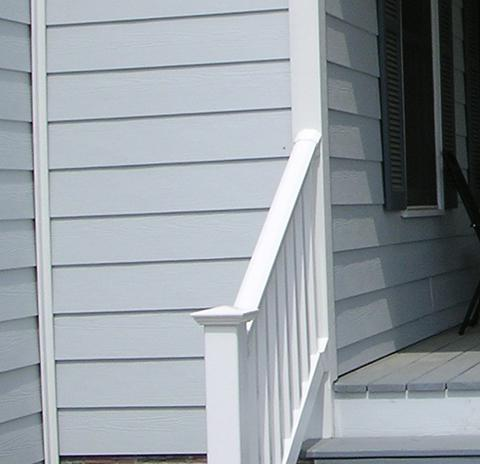A house with Hardiplank siding and PVC trim and porch rails