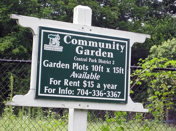 Photo of a community garden welcome sign
