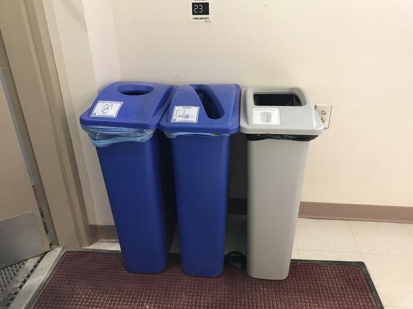 Trash cans with open lids