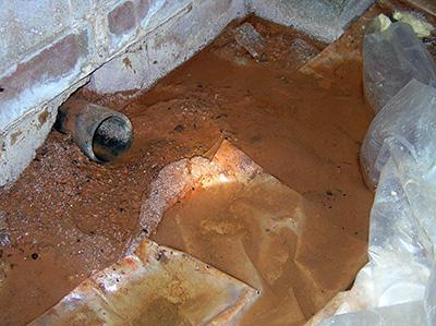 Figure 10. Standing water in a crawlspace.